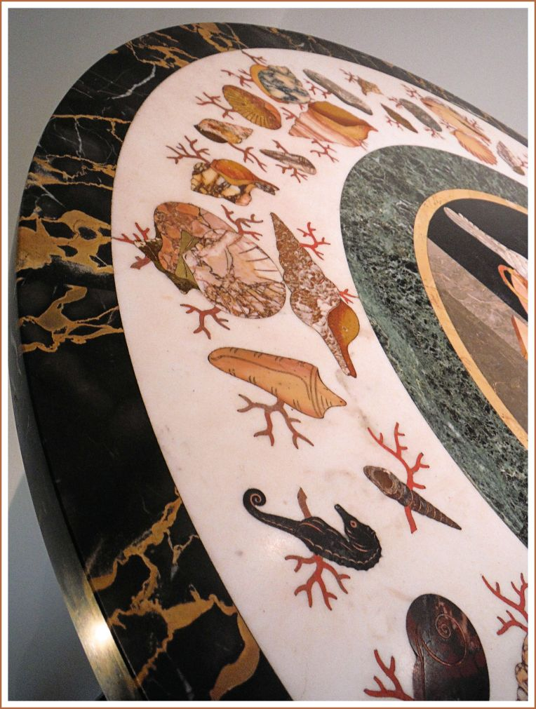 Stone seashells decorating a 19th century table top in 'pietre dure' style.