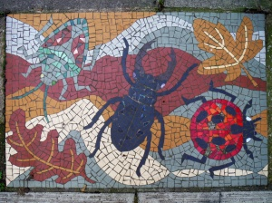 Pavement mosaic with insect images