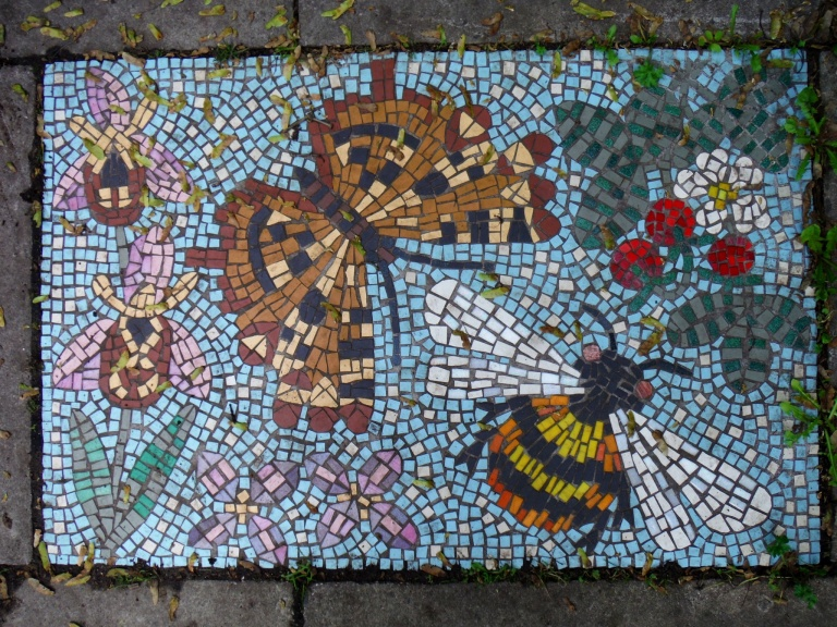Mosaic pavement picture with butterflies and bees