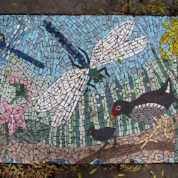 Mosaic pavement picture with dragonflies and water birds