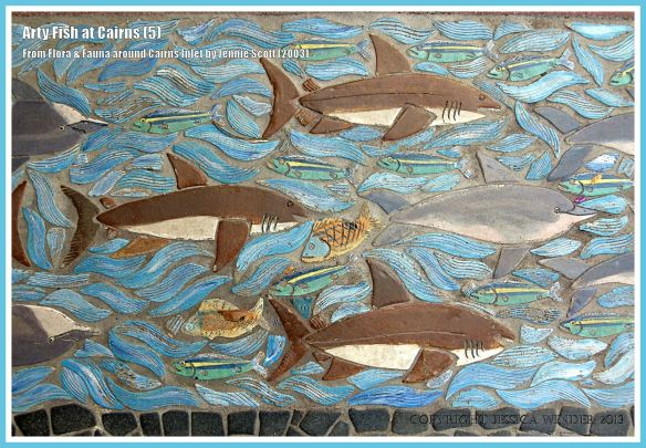 Cairns fish celebrated in ceramic art form on Cairns Esplanade pavement - fish shown with sharks and dolphins