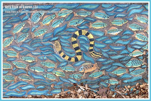 Cairns fish celebrated in ceramic art form on Cairns Esplanade pavement - fish shown with snake