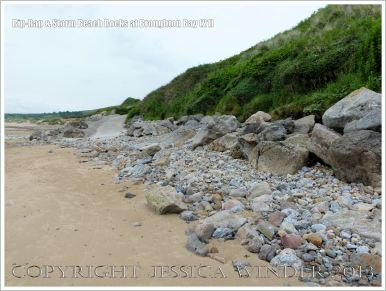 Boulders on the beach as a defence against coastal erosion