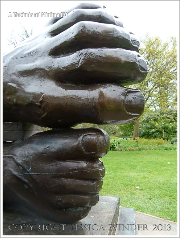 "Feet on the sculpture entitled ""A Maximis Ad Minima"" by Sir Eduardo Paolozzi (1998)"