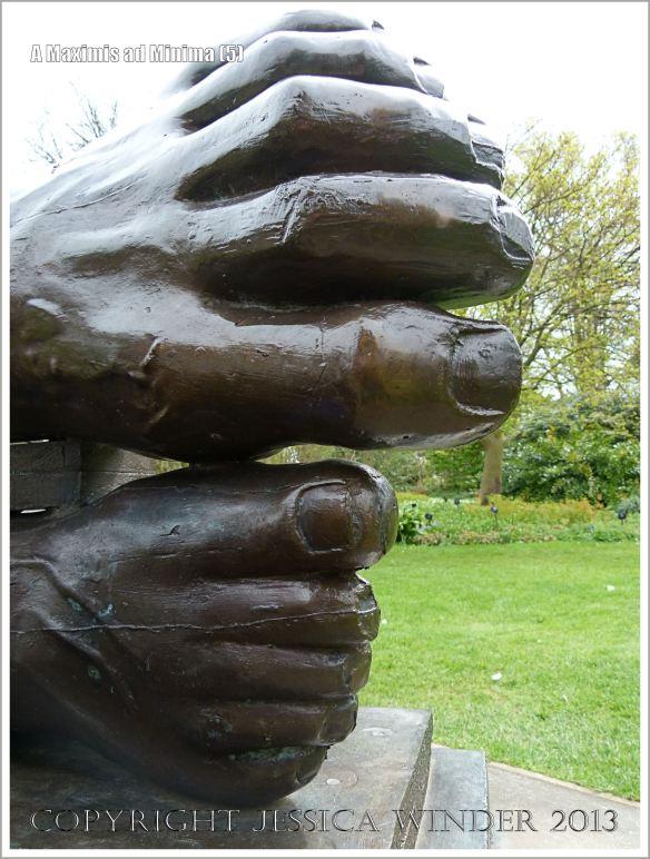 "Feet on the sculpture entitled ""A Maximis Ad Minima"" by Sir Eduardo Paolozzi (1998)"
