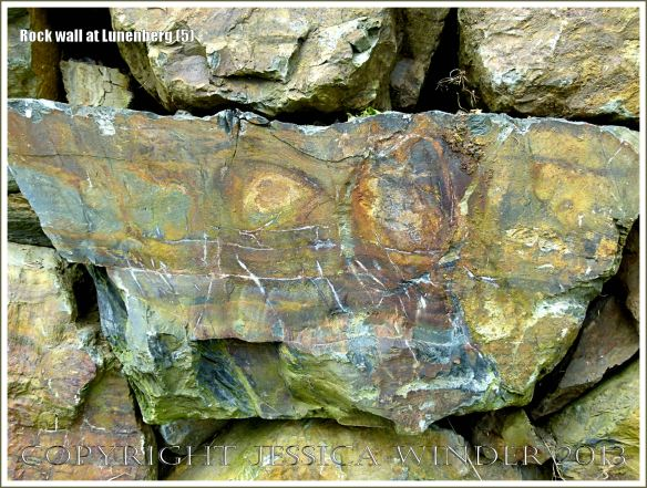 Natural rock colours, patterns, and textures in a wall at Lunenberg