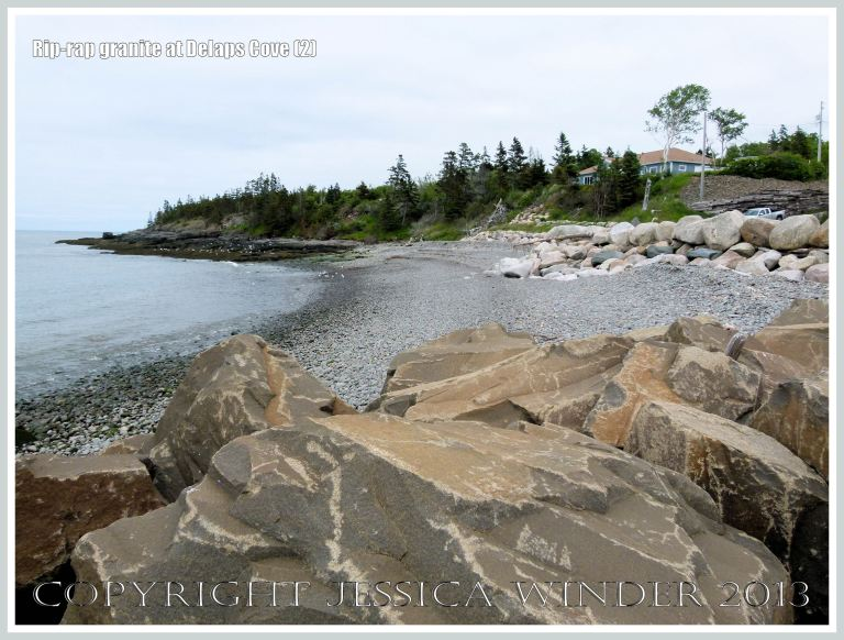 View of Delaps Cove showing sea defence rip-rap (mainly granite) rock boulders