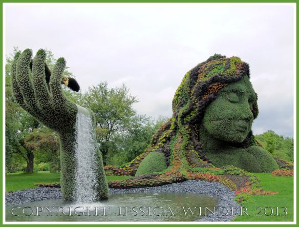 "Mosaiculture tableau of sculptures made with living plants entitled ""Mother Earth"""