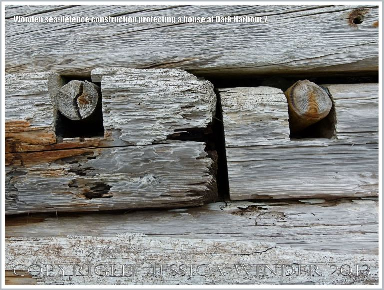 Detail of a sea defence structure built with driftwood timbers