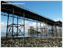 View of the old Life Boat Station through the girderwork supporting Mumbles Pier