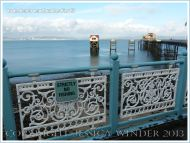 View of the pier and Life Boat Station from ornamental railings at Mumbles Pier, near Swansea, South Wales.