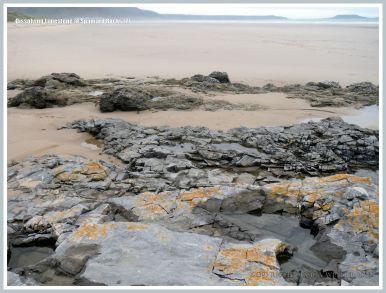 General view from Spaniard Rocks across Rhossili beach to Worms Head