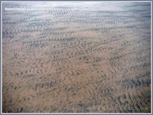 Natural patterns in the sand left by the out-going tide