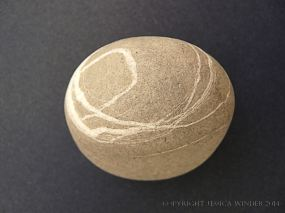 Beach stone with a pattern
