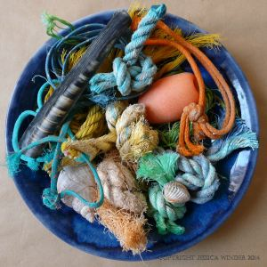 An arrangement of flotsam rope and string knots with shells