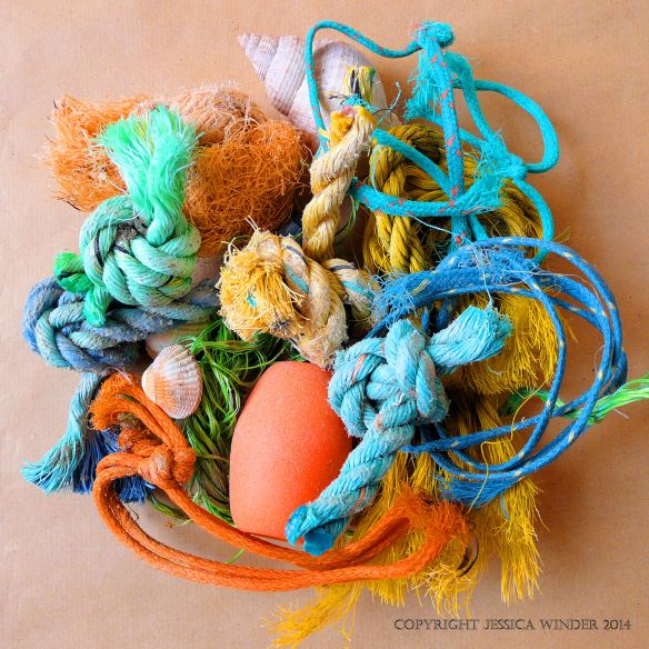 An arrangement of flotsam rope and string knots with a fishing float