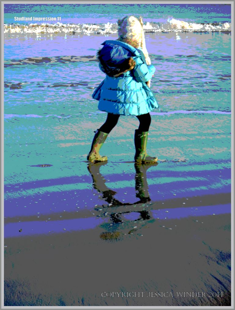 Sea, surf, sand ripples and happy child on the seashore