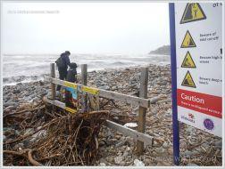 Cliff danger warning signs on a Dorset beach