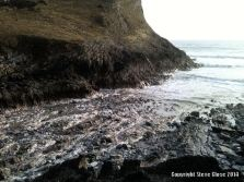 Bare rocks revealed where storms washed away the sand at Mewslade Bay