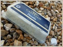 Flotsam tub of cheese washed ashore at Ringstead Bay