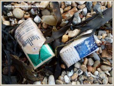 Flotsam packets of cigarettes washed ashore at Ringstead Bay