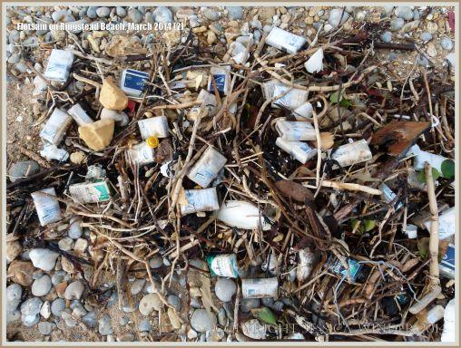 Flotsam packets of cigarettes washed ashore at Ringstead Bay
