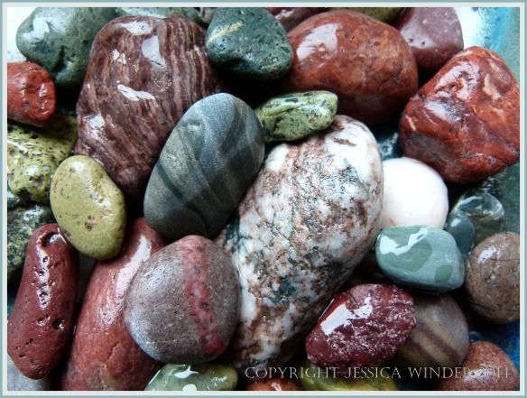 An assortment of patterned and coloured pebbles