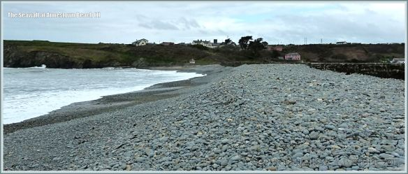 Pebble bank on the seashore retained by a seawall
