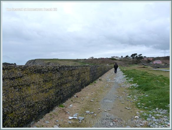 View of the sea wall at Annestown looking west