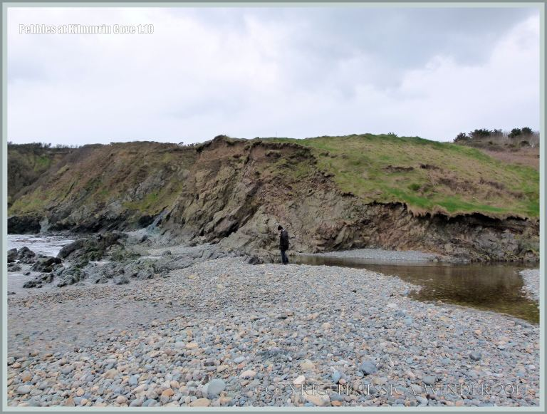View of the west end of Kilmurrin Cove showing river dammed by large pebble bank.