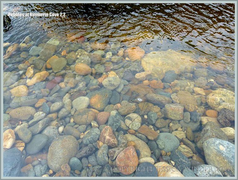 Pebbles underwater in a beach stream