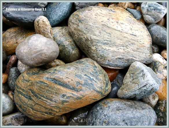 Wet beach stones of volcanic rock