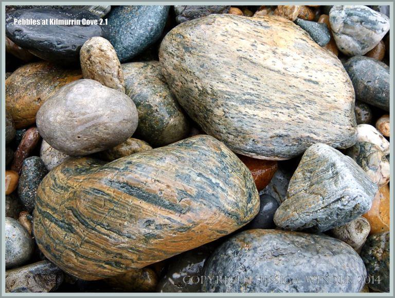 Wet beach stones of volcanic rock