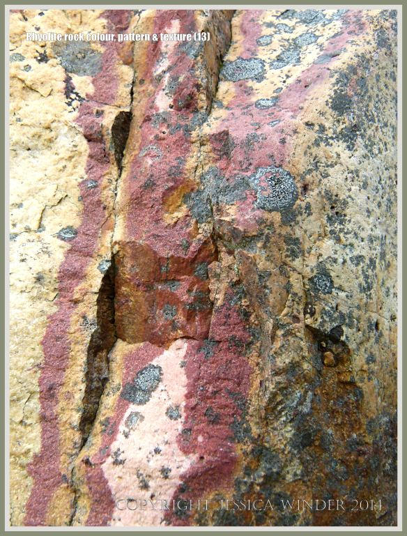 Rhyolite volcanic rock with red streaks