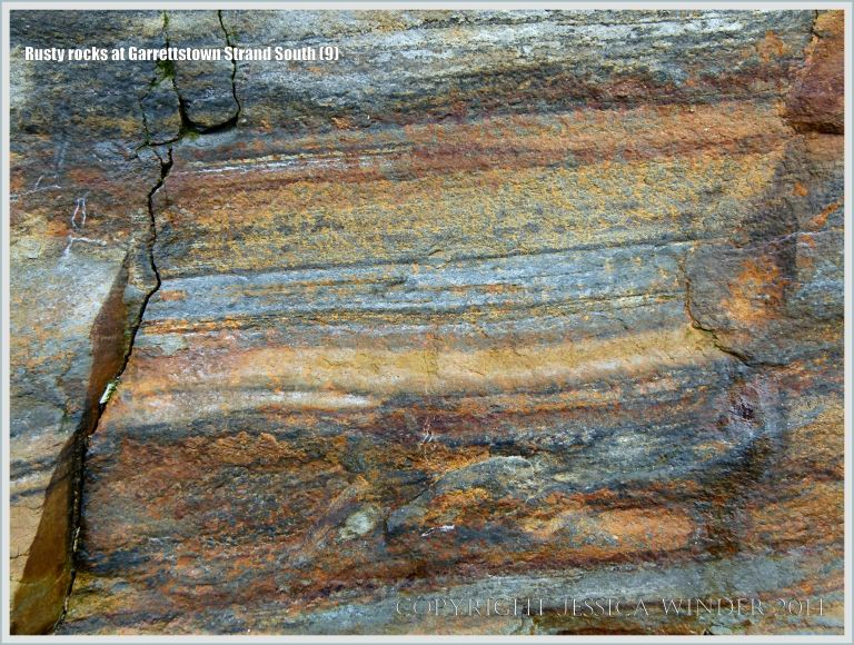 Close-up of rocks layers coloured by their iron content