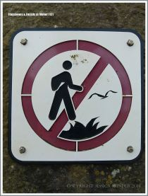 Warning sign against walking on cliff edge and disturbing wildlife