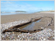 Shipwrecked wooden boat on the beach