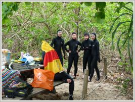Young girls in stinger suits on Normanby Island.