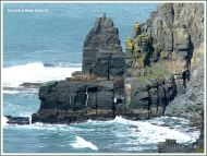 Sea stack and sea stumps caused by erosion at the Cliffs of Moher.