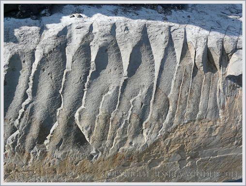 Jurassic limestone breakage pattern in a boulder on Monmouth Beach