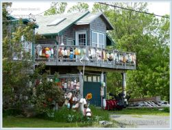 House decorated with fishing floats on Grand Manan
