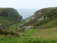 View looking down Mewslade valley to the sea