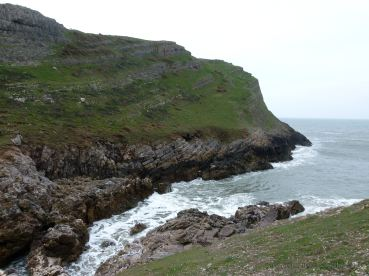 Looking east towards the sloping strata of Thurba Head at Mewslade Bay