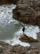 Looking down to the ebbing tide at the mouth of Mewslade Bay