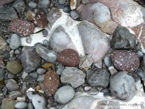 Bedrock and water-worn beach stones in the fault gully at Mewslade Bay