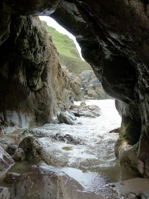 Arch through the limestone cliffs at Mewslade Bay