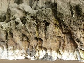 Band of white calcite exposed at the base of the cliffs in Mewslade Bay