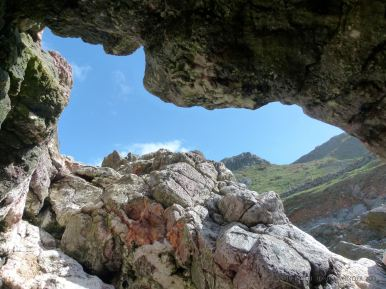 View through a blow-hole in the rocks at Mewslade Bay