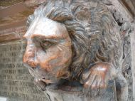 Lion carved in stone as a small part of a larger commemorative piece