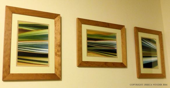 Group of framed pictures of abstract striped pattern in leaves on the wall